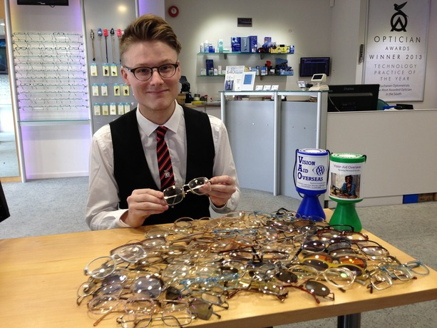 Sean Clarke collecting spectacles for Vision Aid Overseas at opticians Buchanan Optometrists, Kent